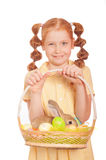 Little girl with a rabbit in  basket easter eggs Royalty Free Stock Images