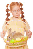 Little girl with a rabbit in  basket easter eggs Stock Images