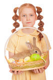 Little girl with a rabbit in  basket easter eggs Royalty Free Stock Photos