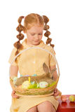 Little girl with a rabbit in  basket easter eggs. Little girl with a  rabbit in a basket easter eggs Royalty Free Stock Images