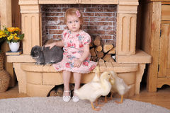 Little girl with rabbit and ducks. Little girl baby with rabbit and ducks royalty free stock photo