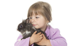 Little girl with rabbit Stock Photo