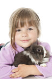 Little girl with rabbit Stock Photos