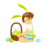Little girl-bunny with a basket of eggs Stock Image