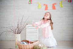 Little girl with rabbit and easter decorations Stock Image