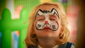Little girl rabbit face painted for Easter party royalty free stock photo