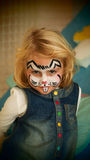Little girl rabbit face painted for Easter party royalty free stock images