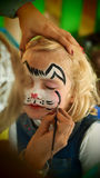 Little girl rabbit face painting for Easter party stock image