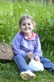 Little girl and rabbit on the grass Stock Photos