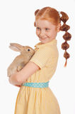 Little girl with rabbit in  hands Stock Photo