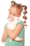 Little girl with rabbit in  hands Stock Images