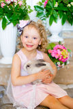 Little girl with a rabbit Stock Image