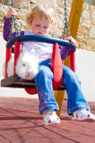 Little girl and rabbit on the swings Royalty Free Stock Photography