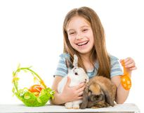 Little girl with rabbits Royalty Free Stock Photo
