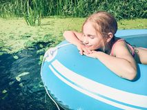 Little girl in a raft Stock Photo