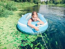 Little girl in a raft Stock Photos