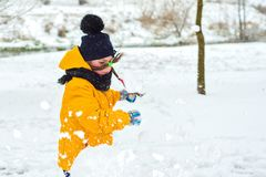 Little girl in a rage broke a snowman. Angry little girl in rage broke snowman stock photography