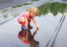 little girl in the rain Stock Photography