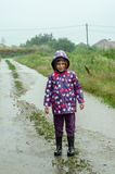 Little girl in the rain Stock Photo