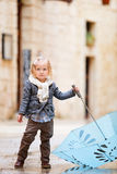Little girl on rainy day Stock Photography