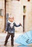 Little girl on rainy day Stock Photography
