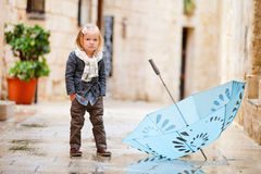 Little girl on rainy day Royalty Free Stock Photo