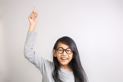 Little Girl Raise Her Hand and Pointing Finger Up Stock Image