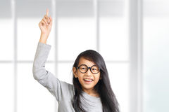 Little Girl Raise Her Hand and Pointing Finger Up Royalty Free Stock Photos