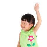 Little girl raise left hand Royalty Free Stock Images