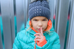 The little girl raised finger to his lips Royalty Free Stock Image