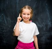 Little girl  raised a finger up Royalty Free Stock Photo