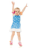 Little girl raised her hands up Stock Images