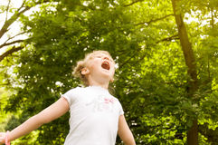 Little girl raised her hands up Royalty Free Stock Photography