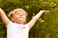 Little girl raised her hands up Royalty Free Stock Images
