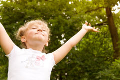 Little girl raised her hands up Royalty Free Stock Image