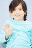 Little girl raises hand in waving Stock Images