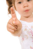 Little girl raising finger Royalty Free Stock Photography