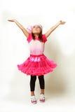 Little girl raising hands Stock Images
