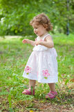 Little girl ran across  green grass Stock Photography