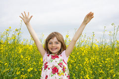 little girl with rapeseed Royalty Free Stock Images