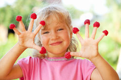 Little girl with raspberry Stock Photo