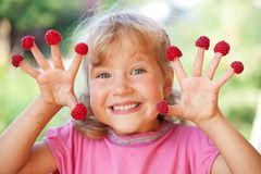Little girl with raspberry Royalty Free Stock Image