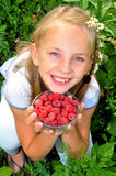 Little girl with raspberry. In her hands Royalty Free Stock Photography