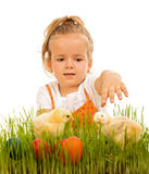 Little girl reaching for the eatser eggs Royalty Free Stock Photo