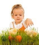 Little girl reaching for the eatser eggs Royalty Free Stock Photo
