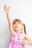 Little Girl Reaching For Something With His Hands. Royalty Free Stock Images