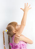 A little girl reaching for something Stock Photography