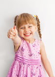 Little girl reaching for something with his hands. Stock Photography