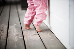 Little girl reaching up. Outdoors royalty free stock images