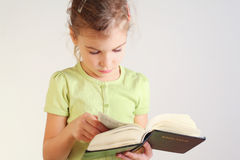 Little girl read bible Stock Images